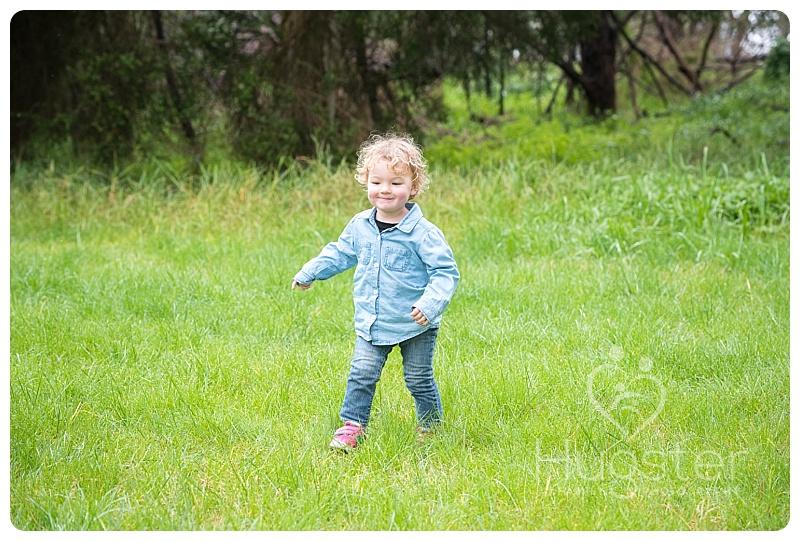 Walking little boy in the park