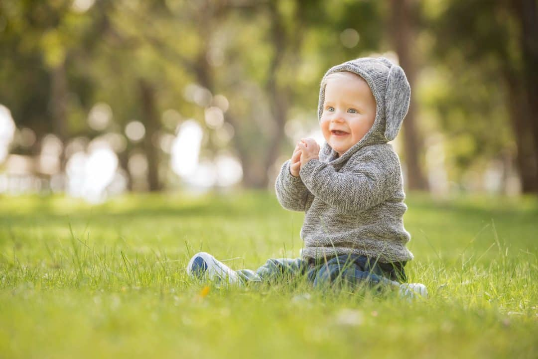 Cute little kid in hoodie at the park